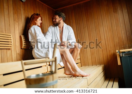 Couple enjoying finnish sauna during their spa weekend - stock photo