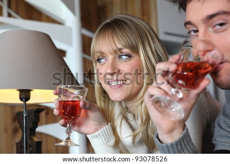 Couple enjoying glass of wine at home