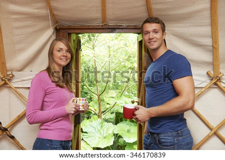 Couple Enjoying Luxury Camping Holiday In Yurt - stock photo