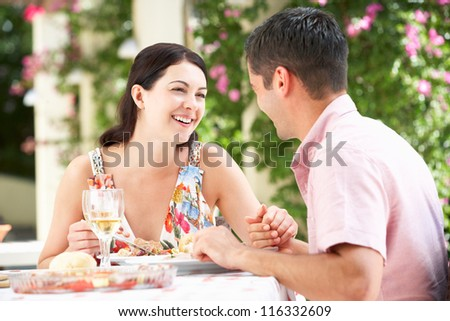 Couple Enjoying Meal outdoorss - stock photo