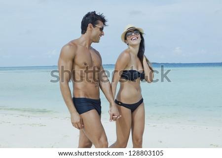 Couple enjoying on the beach - stock photo
