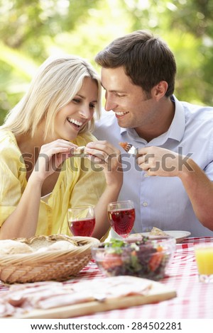 Couple Enjoying Outdoor Meal Together - stock photo