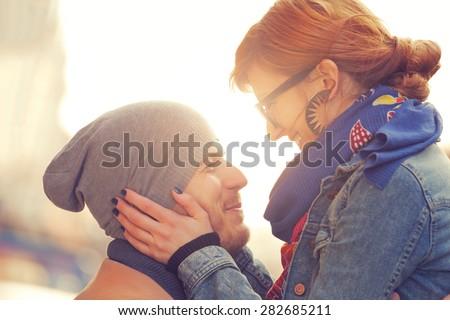 Couple enjoying outdoors in a urban surroundings. - stock photo