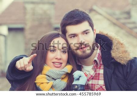 Couple enjoying outdoors in a urban surroundings - stock photo