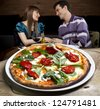 Couple enjoying pizza - stock photo