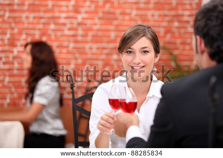 Couple enjoying romantic meal in restaurant - stock photo
