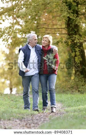Couple enjoying romantic walk - stock photo
