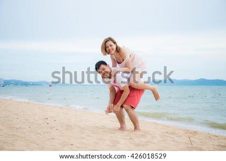 Couple enjoying the beach - stock photo