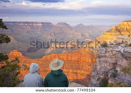 Couple Enjoying the Beautiful Landscape of the Grand Canyon Sunset.