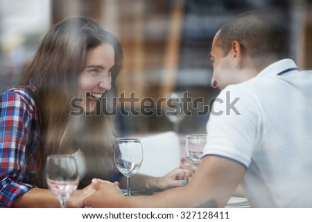 Couple enjoying their love at the restaurant - stock photo