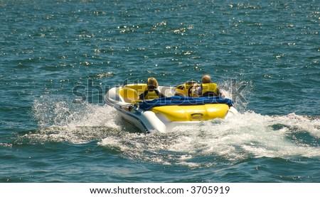 Couple Enjoys Power Boat on Summer Day - stock photo