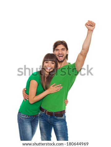 couple excited happy smile hold fist ok yes gesture, man and woman wear green t shirt raised hands arms, isolated white background
