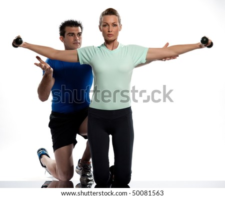 couple exercising workout on white background with weights - stock photo