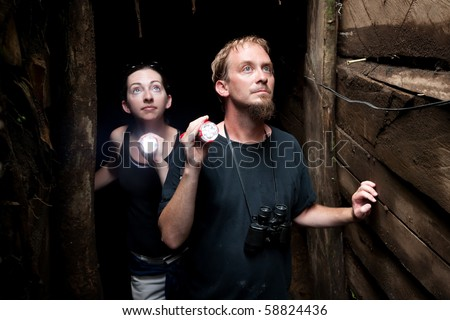Couple exploring rustic abandoned gold mine in Costa Rica - stock photo