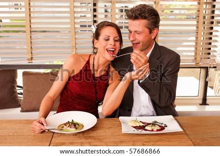 couple feeding each other - dessert - food - stock photo