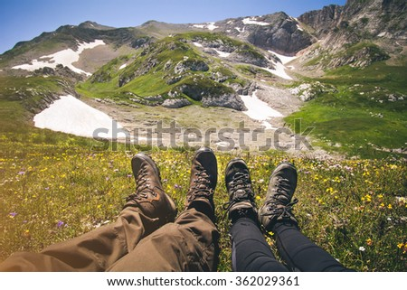 Couple Feet Man and Woman relaxing outdoor Travel Lifestyle and relationship concept mountains on background Summer vacations - stock photo