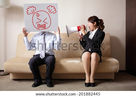 Couple fight with a woman screaming on a megaphone to a man, concept for real marriage life - stock photo