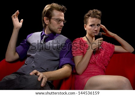 couple fighting and dressed for a night out - stock photo