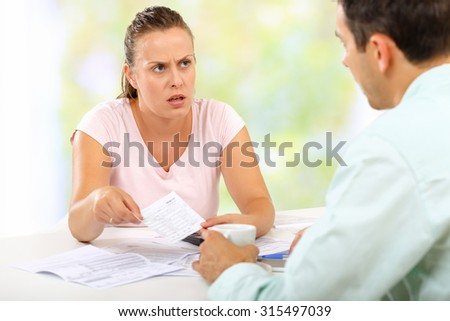 Couple fighting over expenses at home - stock photo