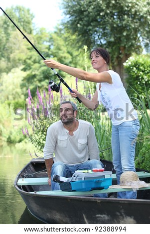 couple fishing in a bark - stock photo