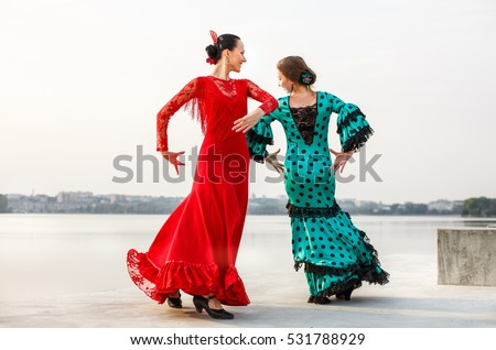 couple Flamenco dancers Spain womans in a long dress, dancing outside near the lake