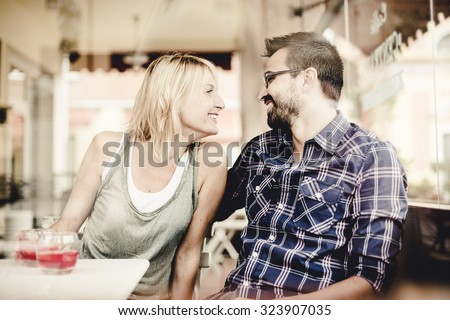 Couple flirting at the Bar - stock photo