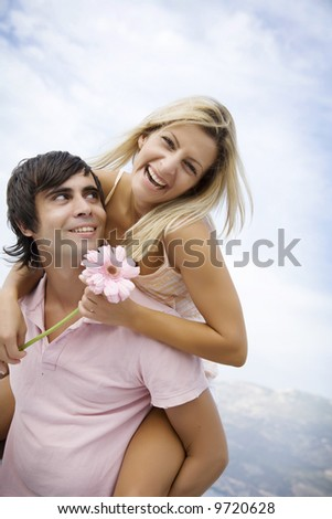 couple fooling around outdoors on a ummers day