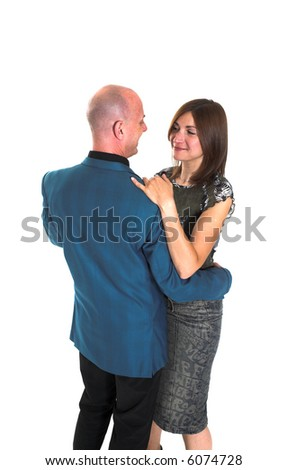 couple full body shot dancing over white backdrop