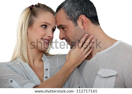 Couple gazing in to each others eyes - stock photo