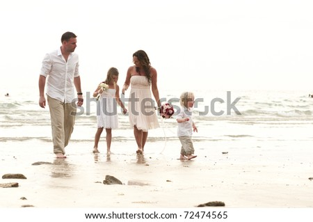 couple get married on beach with there children