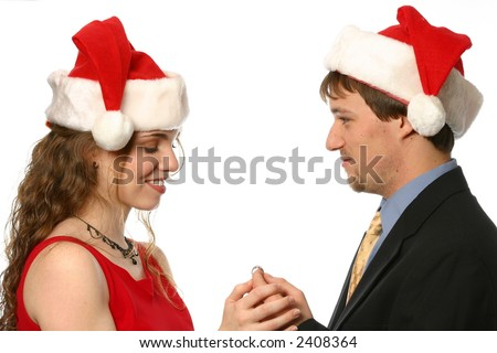 Couple getting engaged at Christmas - stock photo
