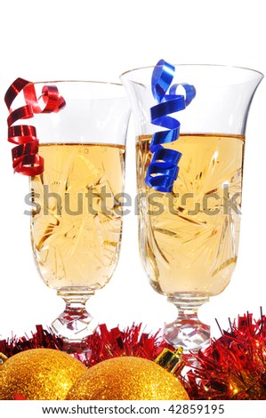 Couple glasses of champagne with gold streamer on white background - stock photo
