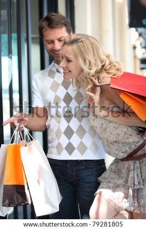 Couple go on a shopping spree - stock photo