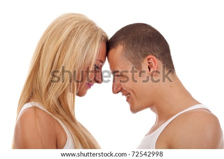couple going head to head, smiling, isolated - stock photo