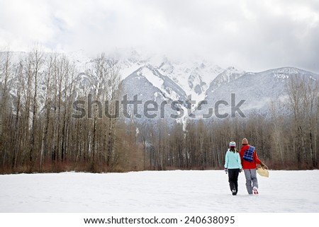 Couple Going on Winter Picnic - stock photo