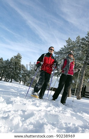Couple going skiing - stock photo