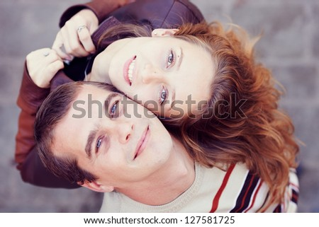 Couple had their backs to each other. Top view - stock photo