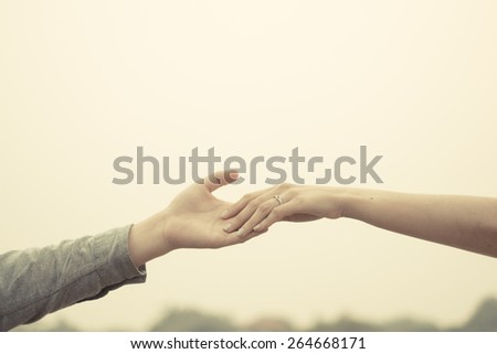 Couple hand together touch with love vintage filter tone. - stock photo