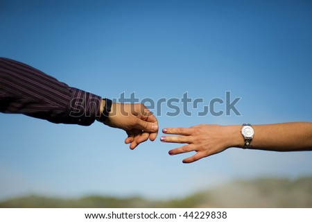 Couple hands in a sky close-up