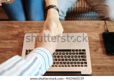 couple handshake with banker ,handshake, businessman hand hold together,Business handshake and business people. Business handshake for closing the deal after singing  contract between companies. - stock photo