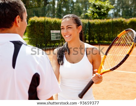 Couple handshaking at the tennis court after playing a game