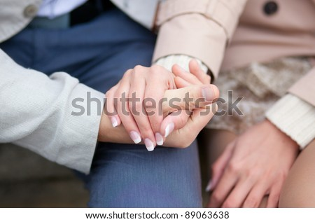 Couple having a date, holding each others hands - stock photo