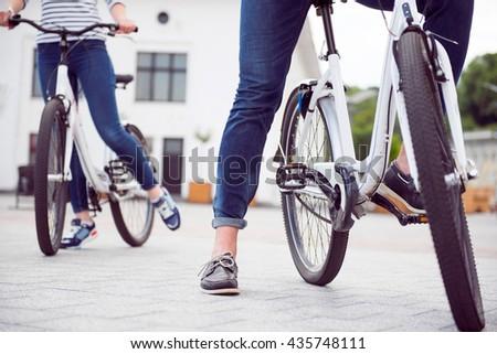 Couple having a meet on bikes - stock photo
