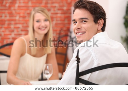 couple having a romantic dinner in a restaurant - stock photo