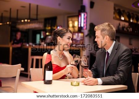 couple having anniversary celebration in  restaurant - stock photo