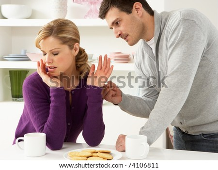 Couple Having Argument At Home - stock photo