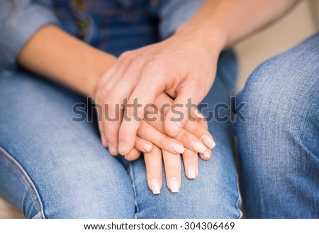 Couple having big trouble in relations. Husband comforting his wife. Close-up. - stock photo