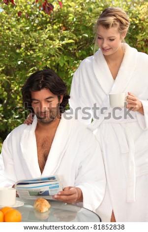 Couple having breakfast outside - stock photo