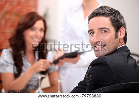 Couple having date at the restaurant - stock photo