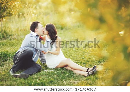 Couple having date, spending great time in garden on summer sunny day.